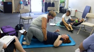 A woman doing a pelvic lift Madriella Doula Workshop hosted by Corey Strouse