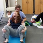 A woman doing the birth pose at a Madriella Doula Workshop hosted by Corey Strouse