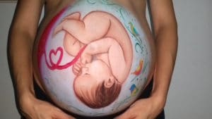 beautiful painting of a baby in the womb painted on a pregnant womans belly