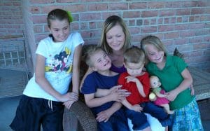 Happy family with developmentally disable twins